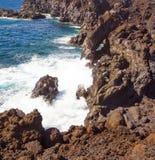 Sikt av Los Hervideros del Agua arkivbild