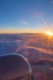 Sikt av moln på soluppgång Arkivfoto