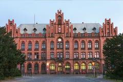 Sikt av Polen. Gammal byggnad av stolpen - kontor Arkivfoto