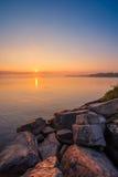 Sikt av Simcoe sjön under soluppgång Arkivbild