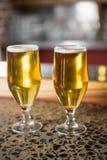 Sikt av två halva liter av öl Fotografering för Bildbyråer