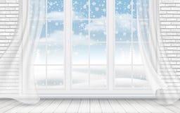 Sikt av vinterlandskapet till och med fönstret Arkivbild