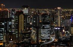 Sikt för belysning för natt för Osaka stad flyg- i det Umeda området, Osa Fotografering för Bildbyråer