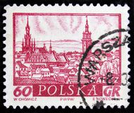 Sikt för shower för Polen portostämpel av Kalisz - staden i mitt av Polen, Silesia, circa 1960 Royaltyfria Foton