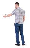 Sikt för tillbaka sida av mannen i skjortahandskakning arkivfoto
