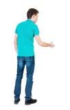 Sikt för tillbaka sida av mannen i skjortahandskakning arkivbild