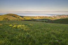 Sikt från kullen på solnedgången Fotografering för Bildbyråer