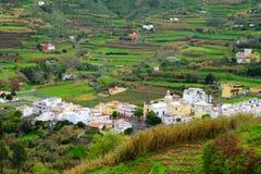 Sikt på en by i den centrala delen av kanariefågelön Gran Canaria, Spanien - 13 02 2017 Fotografering för Bildbyråer