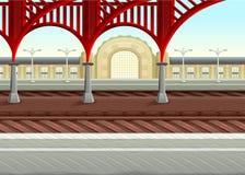 Sikt på järnvägar i drevstationen Arkivbild