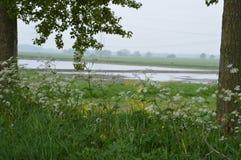 Sikt på jordbruksmark Arkivbild