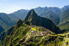 Sikt på Machuen Picchu på en solig dag Arkivfoto