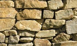 Sikt på texturen av stenväggen av orange färg Royaltyfria Foton