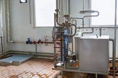 Sikt på utrustningen på mjölkafabriken Royaltyfria Bilder