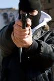 sikta den beväpnade brottslingen dig royaltyfria bilder