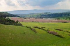 Sikten av gräsplanfält i Slovakien Fotografering för Bildbyråer