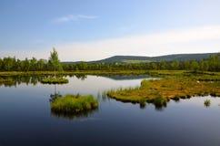 Sikten av sjön med öar Arkivbild