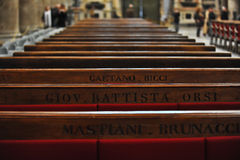 Silance. Old wood bench in catholic church Stock Photography