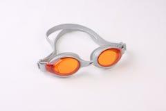 Silber u. orange Swim-Schutzbrillen Stockbild