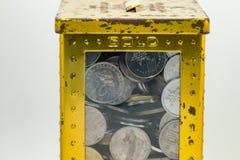 Silber- und Goldfarbe von malaysischen Münzen Stockfotos