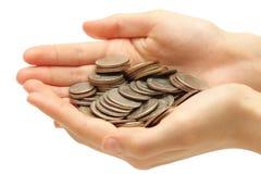 Silbermünzen in den Händen getrennt auf Weiß lizenzfreies stockbild