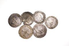 Silbermünzen der Weinlese mit Porträts auf einem weißen Hintergrund Lizenzfreies Stockbild