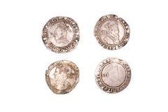 Silbermünzen der Weinlese mit Porträts auf einem weißen Hintergrund Stockfotografie