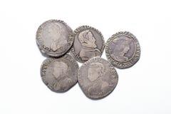Silbermünzen der Weinlese mit Porträts auf einem weißen Hintergrund Lizenzfreie Stockbilder
