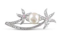 Silberne Brosche mit Perle lizenzfreies stockbild