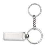 Silberne Schlüsselkette auf weißem Hintergrund Lizenzfreies Stockfoto