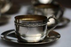 Silberne Teeschale mit Untertasse Stockbild