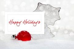 Silberne u. rote Weihnachtsverzierung mit Feiertags-Karte Stockfotos