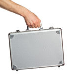 Silberner Metallaktenkoffer in der Hand Lizenzfreie Stockfotos