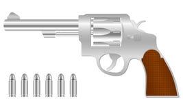 Silberner Revolver und Gewehrkugeln Stockfotografie