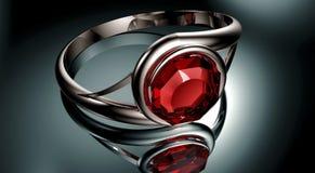 Silberner Ring mit rotem karminrotem Stein Stockfoto