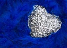 Silbernes glänzendes Herz Stockfotografie