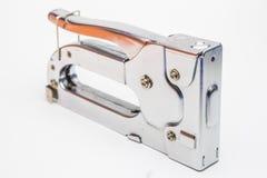 Silbernes Heftergewehr auf weißem Hintergrund Stockfoto