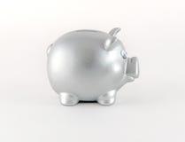 Silbernes metallisches Sparschwein-Seitenansicht Stockfotografie