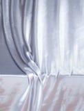 Silbernes silk Drapierung Lizenzfreie Stockbilder