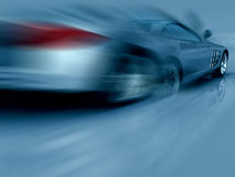 Silbernes Sport-Auto in der Bewegung Stockfotos