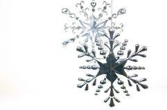 Silbernes und Glasweihnachtshängender Stern Stockfoto