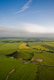 Silbury Hill and lush countryside from balloon. This is an ancient man-made hill in Wiltshire, England. See wikipedia for full details Stock Images