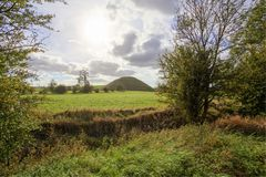 Silbury Hill Wiltshire. Thought to have been completed in 2400 BC the Neolithic Silbury Hill in Wiltshire England is the largest man made mound in Europe. It is stock photography