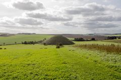 Silbury Hill Wiltshire. Thought to have been completed in 2400 BC the Neolithic Silbury Hill in Wiltshire England is the largest man made mound in Europe. It is royalty free stock images