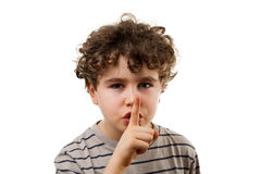 Silence. Young boy with finger on his mouth Royalty Free Stock Photos