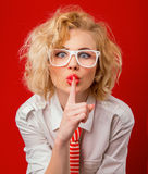 Silence. Woman holding finger on her mouth showing sign silence Stock Photos