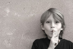 Silence. Little boy asking for silence Royalty Free Stock Photography