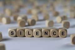 Silence - cube with letters, sign with wooden cubes Stock Photos