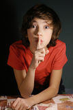 Silence gesture, boy ask for keep important secret. From others, mystery stock images