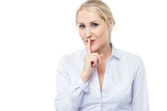 Silence gesture by young corporate lady Stock Photos