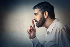Silence. Man showing to stay silence Stock Photography